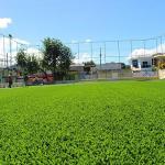 Construção de campo society com grama sintética